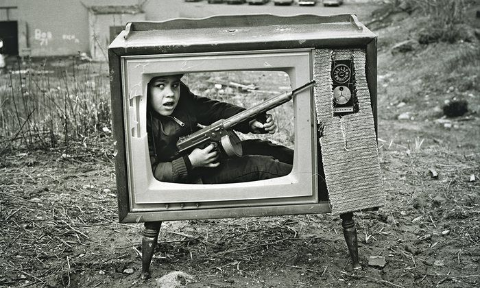 Arthur Tress's best photograph: a boy from the Boston ghetto hides with a gun   Art and design   The Guardian