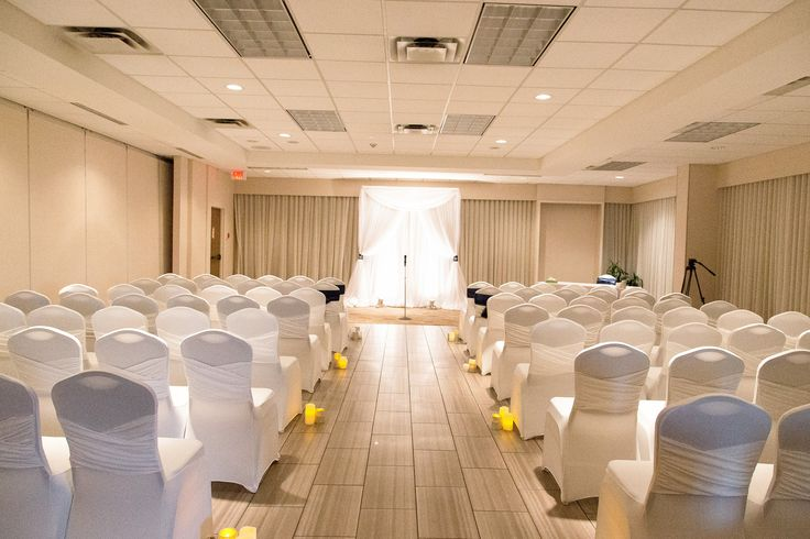 Wedding Ceremony in the Bellevue North. Decor by MT's Wedding Design and photo by Niche Photography.  Holiday Inn Kingston Waterfront #ygk