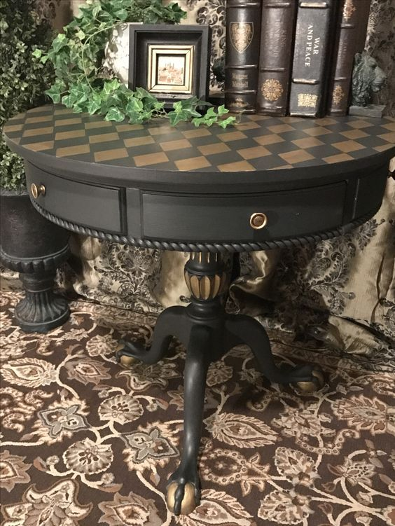 Accent table painted in Annie Sloan Chalk Paint color Graphite with gold harlequin pattern stenciled on top and in details. Sealed with Polyvine dead flat varnish.