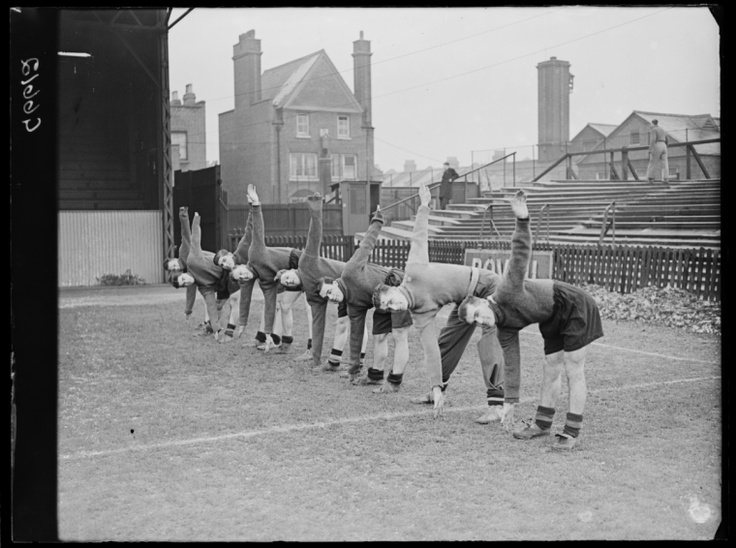 Queens Park Rangers footballers during training, taken in January 1939 by George W Roper.  The players are, from left to right: McCarth, Alf Ridyard (1908-1981), unidentified player, Marsh, James, Reg Allen (1919-1976) and Ted Reay.
