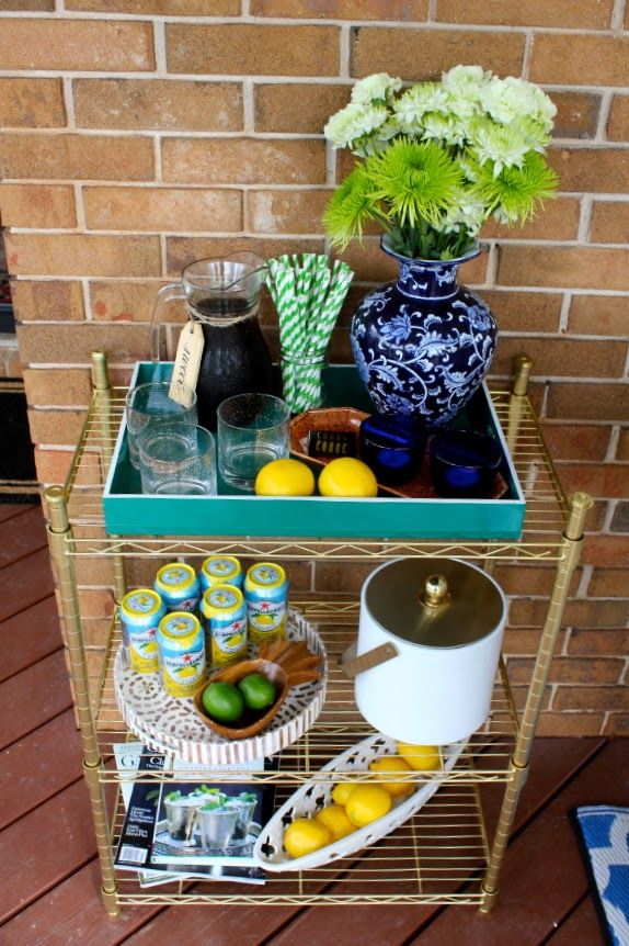 A simple coat of gold spray paint turned this ordinary $20 shelf into a spectacular serving cart.