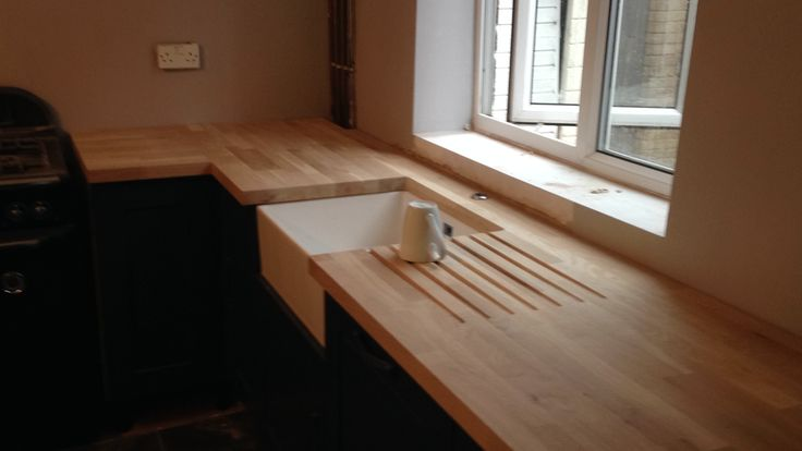 Solid oak worktops with belfast sink cut out and drainage grooves  #worktops #solidoak