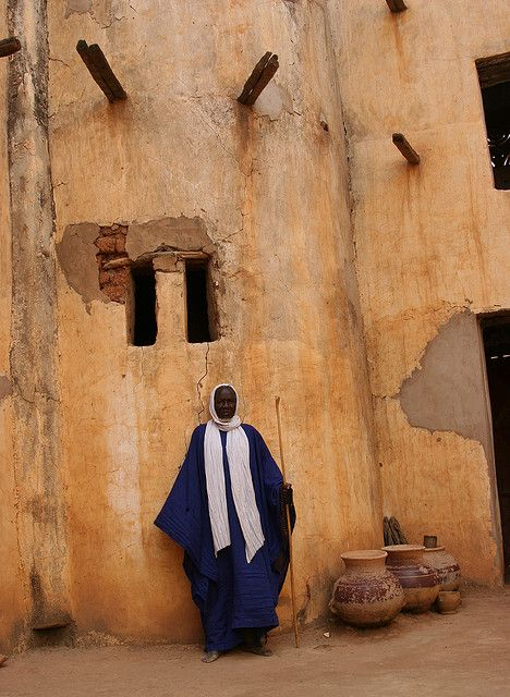 Muezzin in his mosque in Djénné, Mopti, Mali.  The muezzin is a chosen person at the mosque who leads the call (adhan) to Friday service and the five daily prayers (also known as the salat) from one of the mosque's minarets. | © Ferdinand Reus.