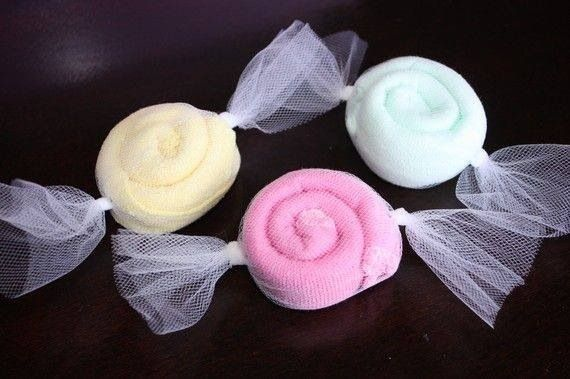 Roll up baby wash cloths and wrap them like candies. Great idea for a baby shower.