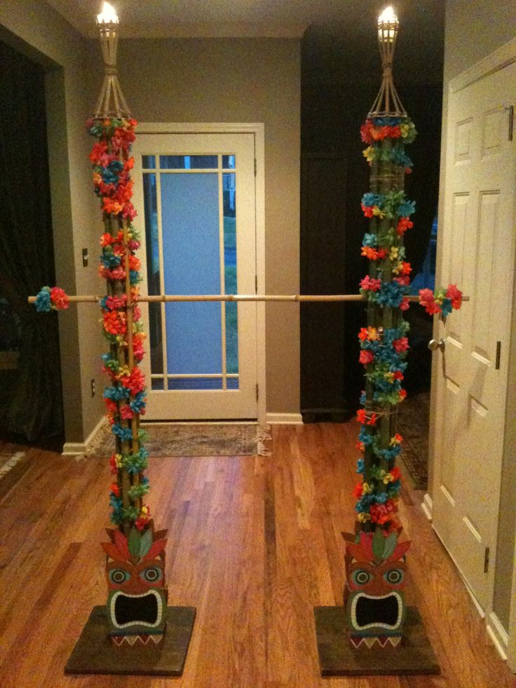 Limbo pole with Tiki Gods and flames at the top for 7yo nieces slumber party.