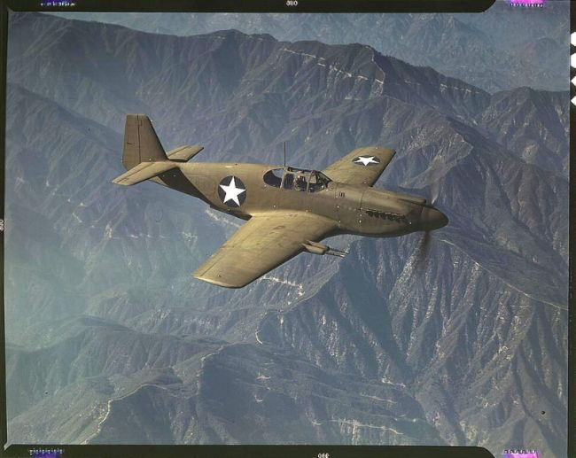 "A North American Mustang Mk. IA on a test flight from NAA's Inglewood, California facility in October 1942. The ""Mustang"", built by North American Aviation, Incorporated, is the only American-built fighter used by the Royal Air Force of Great Britain. The painted-over serial number appears to be 41-37416."