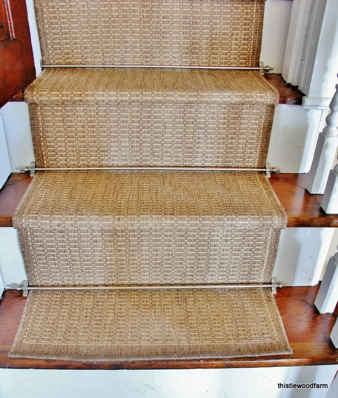 Saddlestich indoor/outdoor stair runners get the fancy treatment with a few brushed nickel staircase rods and finials. A luxe look for less that's durable, too!