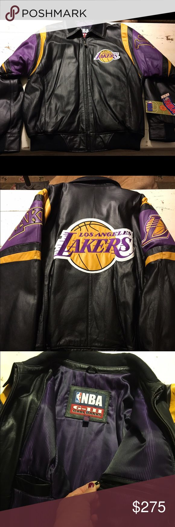 Leather Laker Jacket size large This is a gorgeous new with tags retro leather Lakers jacket with leather collar. There are two inside chest pockets, one with zipper.  The leather is thick as is the jacket with a bright purple lining.  It is a size large and the sleeves will comfortably fit someone with bigger arms.  This jacket is a beauty and was purchased for $335 with the original tag on it. The jacket has been held as a collectors item. NBA Jackets & Coats Bomber & Varsity