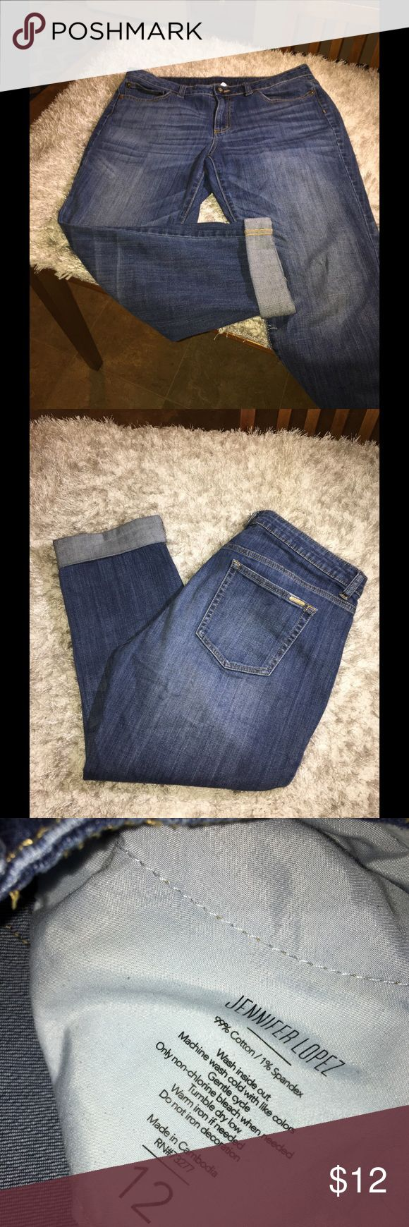 Jennifer Lopez Boyfriend Ankle Jeans Size 12 Ankle length Boyfriend jeans.  Jennifer Lopez.  Medium blue rinse color.  Inseam is 24 inches.  Size 12. Good condition.  Important:   All items are freshly laundered as applicable prior to shipping (new items and shoes excluded).  Not all my items are from pet/smoke free homes.  Price is reduced to reflect this!   Thank you for looking! Jennifer Lopez Jeans Boyfriend