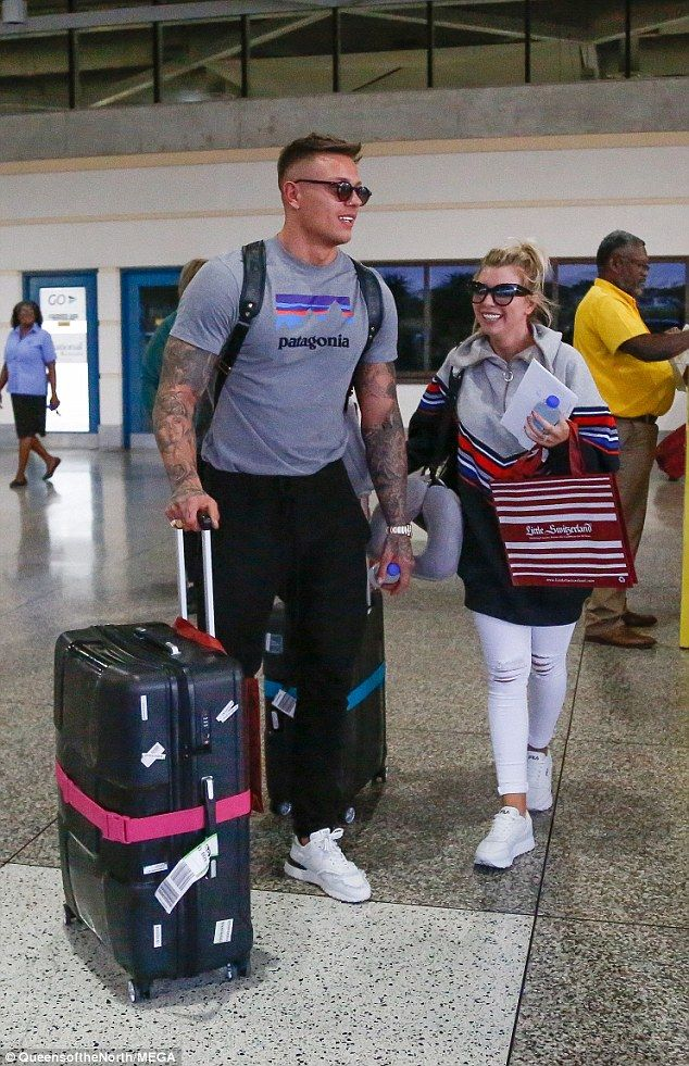 Delighted: Both of the former islanders beamed as they strolled through the airport, revea...
