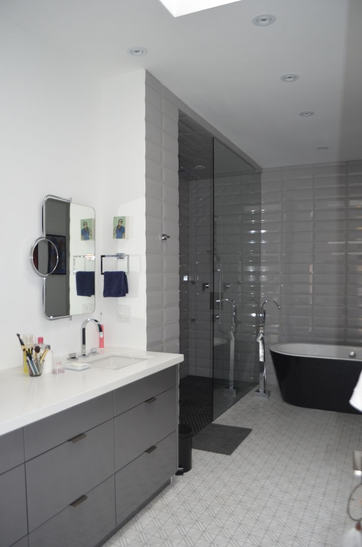 Grey and white scale bathroom. Absolutely gorgeous renovation done in Toronto home