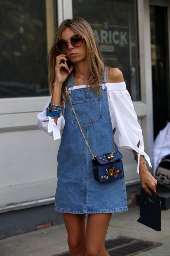 Try an off the shoulder white blouse paired with denim overalls for spring. Let Daily Dress Me help you find the perfect outfit for whatever the weather! dailydressme.com/