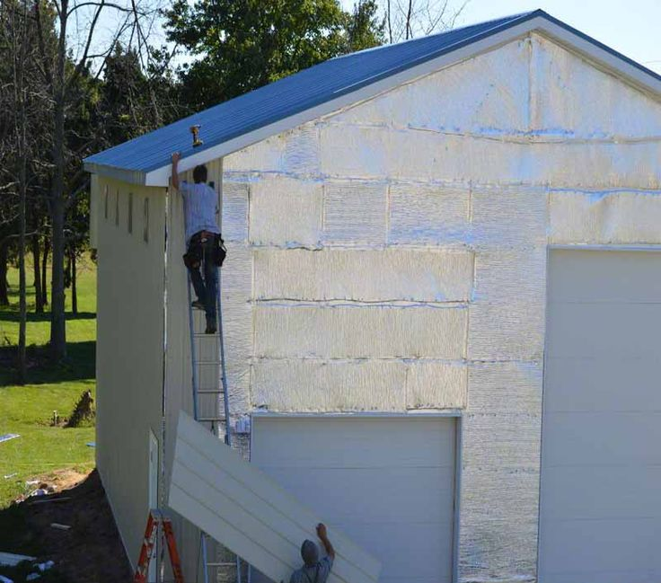 Adding the siding over a layer of radiant heat-blocking InfraStop®. What a great way to regulate internal temperature without increasing energy costs! http://www.insulationstop.com/pole-barn-insulation