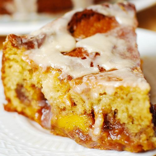 Peach Coffee Cake with Vanilla Glaze:  light and fluffy Greek yogurt cake baked with lots of peaches on top (mixed with brown sugar, cinnamon, and nutmeg),