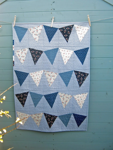 """Pieced (not appliqued) bunting quilt - includes pdf pattern.""  I'd use African shwe shwe fabric and then applique letters to spell something out."