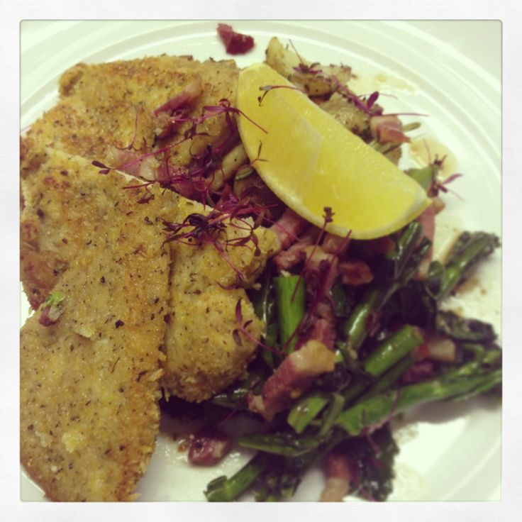 Pollo alla Milanese Cornish free range chicken breast, breaded and pan seared, served with sautéed potatoes and pan fried purple sprouting broccoli tossed with pancetta and chilli