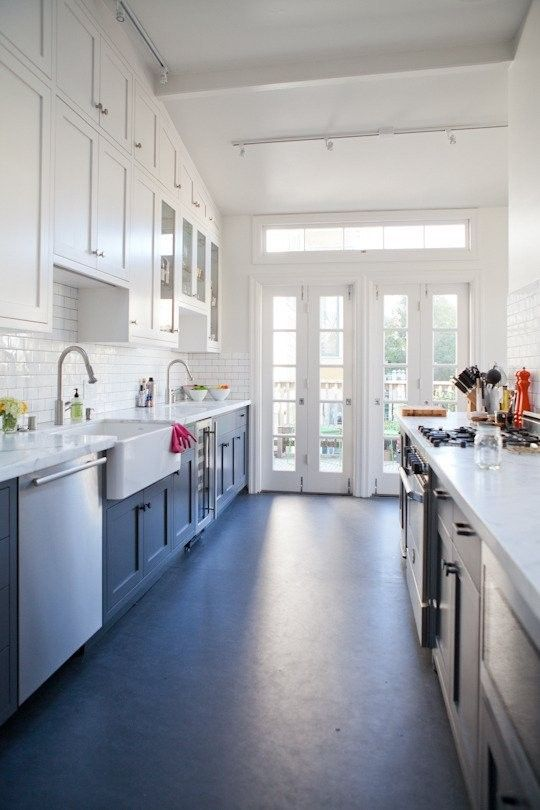 Environmentally-friendly linoleum floor has the look of stone at a fraction of the cost--about $5/square foot. Via Remodelista.