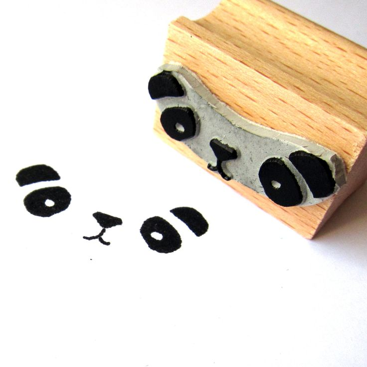 Cute little panda bear stamp, fixed to a wooden half handle. Size: 3,0 cms.
