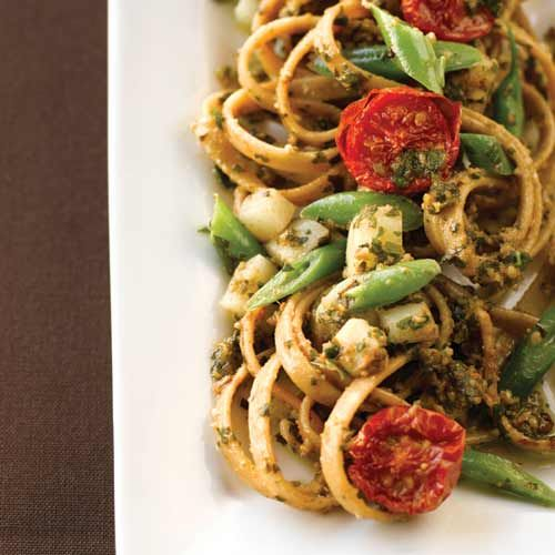 "Rustic Genovese Basil Pesto Pasta - Hell's Kitchen champ Christina Machamer's hearty basil pesto - traditional as it is - isn't ""weighted"" in the past, thanks to Fontinella cheese or low fat parmesan. Plus, you can play around with different herbs to make novel pestos."