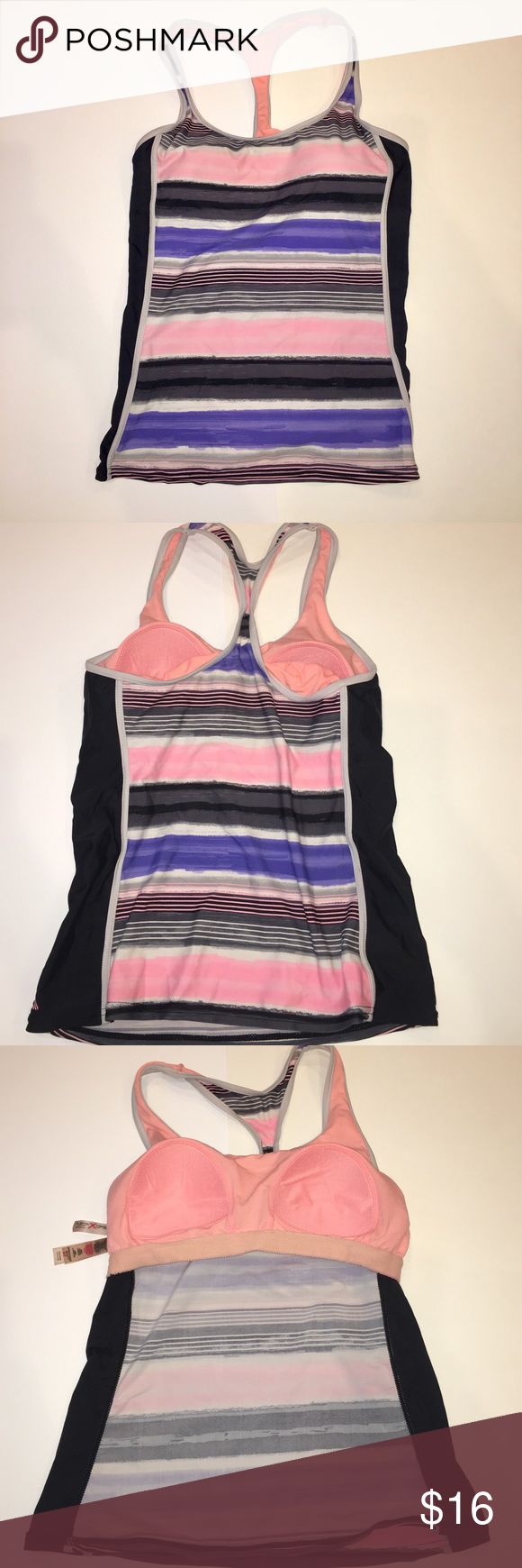 Multicolored tankini Minimal wear. Swimsuit top is in great condition. It has padded cups on the interior. ZeroXposur Swim
