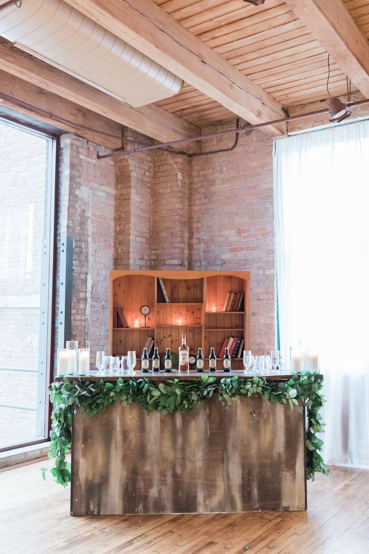 {{Winter wedding bar decorated with southern smilax garland at Bridgeport Art Center in Chicago.}} Photography by Tiffaney Child's Photography http://tiffaneychilds.com/    Flowers by Pollen, pollenfloraldesign.com