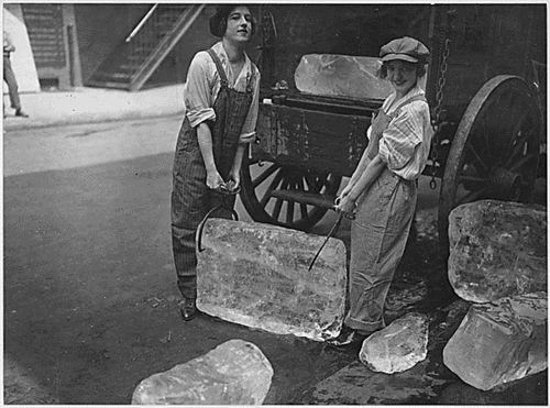 Girls delivering ice. Heavy work that formerly belonged to men only is being done by girls. The ice girls are delivering ice on a route and their work requires brawn as well as the partriotic ambition to help.Circa 1918– From the Records of the War Department