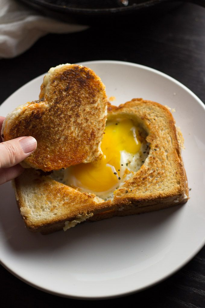 A recipe for an egg cooked in a grilled cheese basket.
