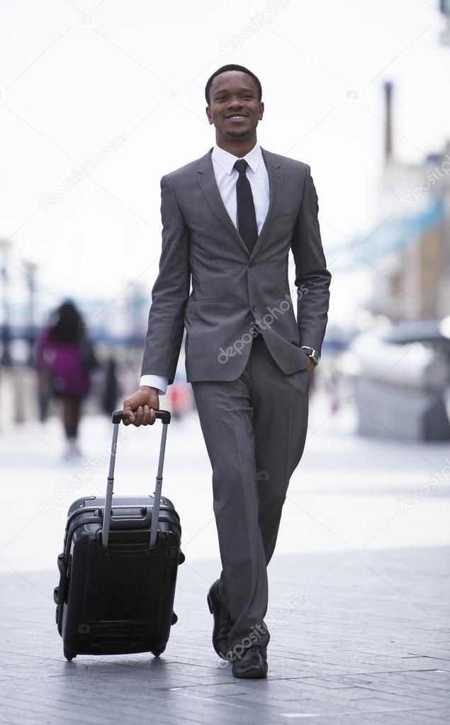 African American Businessman Pulling Suitcase Royalty Free Stock