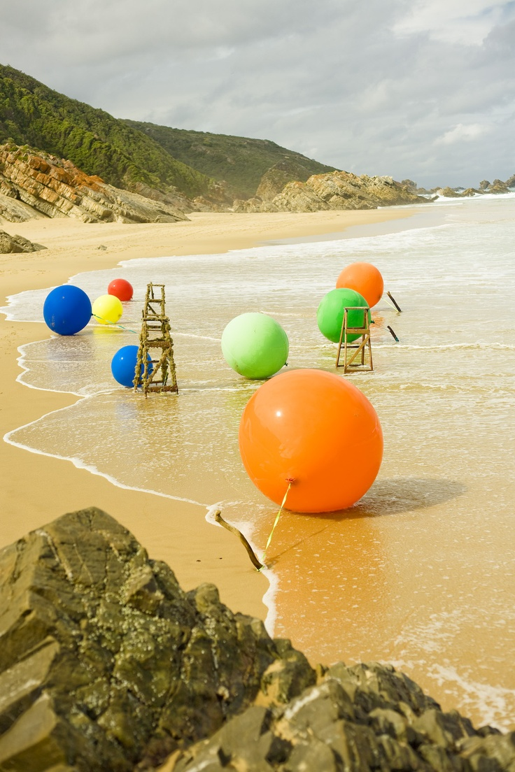Colourful Beach Wedding Ceremony, Keurbooms Beach, Plettenberd Bay.   Massive balloons & ladders love this idea!