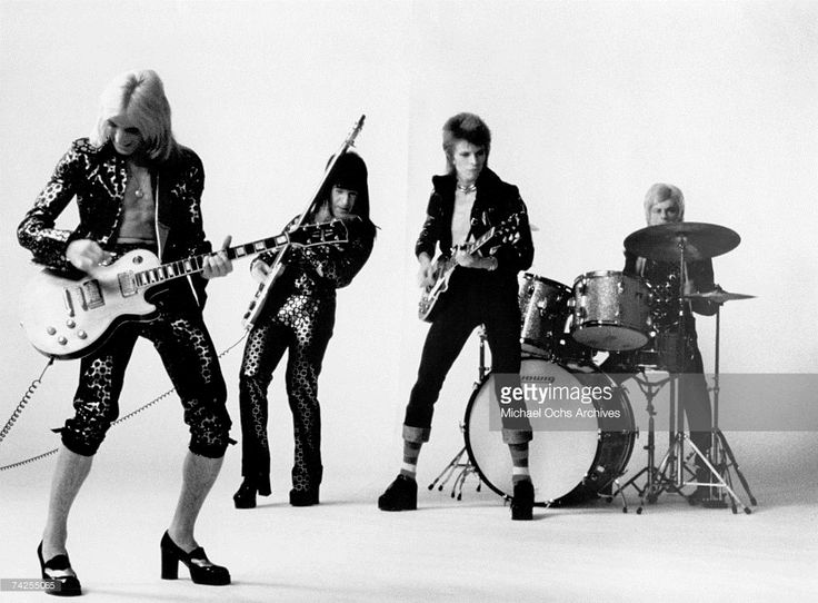 Guitarist Mick Ronson, bassist Trevor Bolder, David Bowie and drummer Mick Woodmansey of 'Ziggy Stardust And The Spiders From Mars' pose for a portrait in November 1972 in London, England.