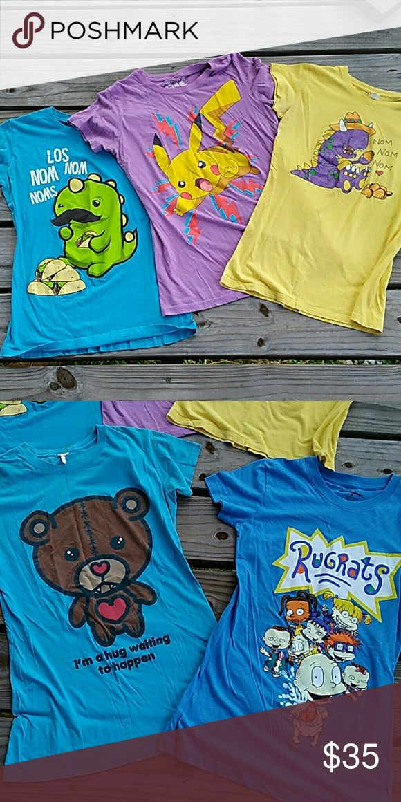 Five graphic tees. Blue Los nom nom noms. Dinosaur eating tacos.   Purple pikachu shirt.  Yellow non nom nom. Dinosaur eating tacos.  Blue teddy bear. I'm a hug waiting to happen.  Blue rugrats cast.    All fit like a medium. Tops Tees - Short Sleeve