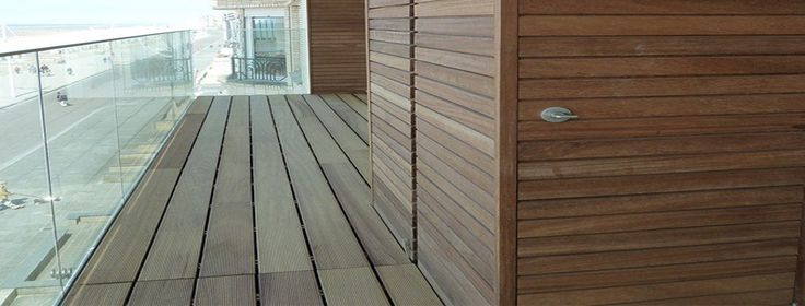 Sea view terrace in padouk wood. With worked in storage. Visit our site for more images and how to do it yourself info.
