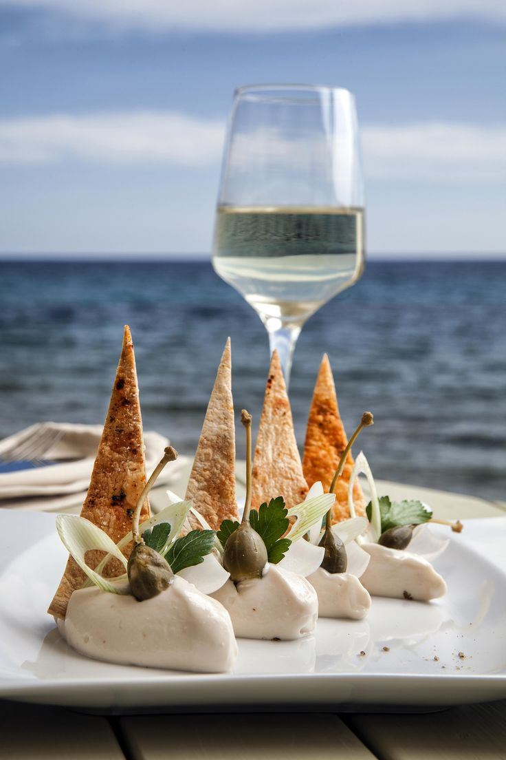 "White ""taramas"" mousse with spring onions, capers, grated delicacy ""avgotaraho"" (bottarga, cured fish roe) and crispy pita bread by Aelia Beach Bar Restaurant."
