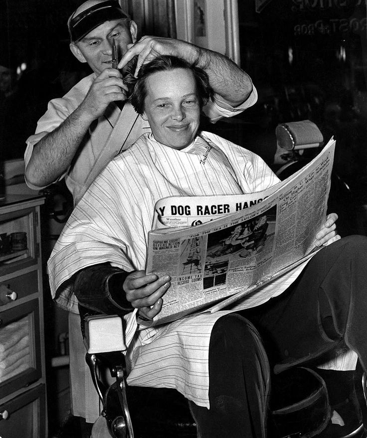 Amelia Earhart getting her last haircut in 1937