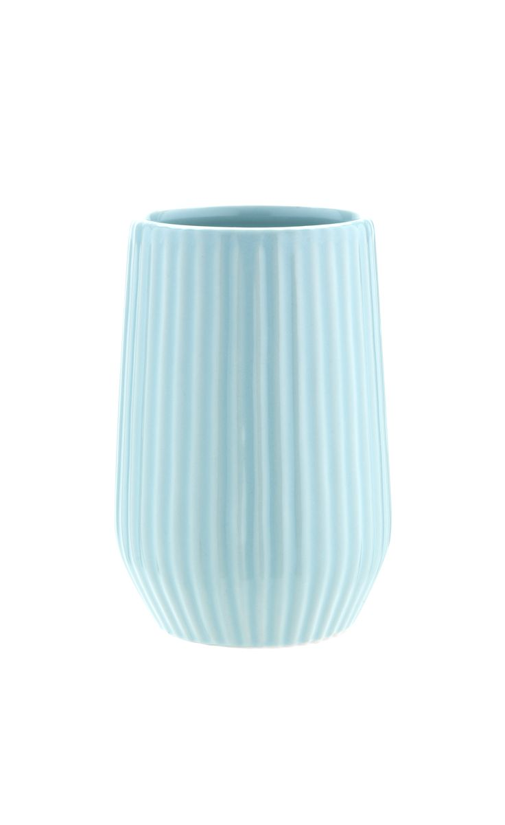 Watery aqua shades are made for the bathroom, giving it a fresh, clean feel. Introduce it via accessories like this tumbler. Priced at £5.