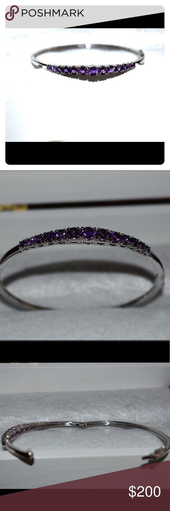 Silver amethyst bangle Bought from qvc. Genuine amethyst stones and small faux diamonds. Absolutely beautiful bracelet. Made for us plus sized ladies Jewelry Bracelets