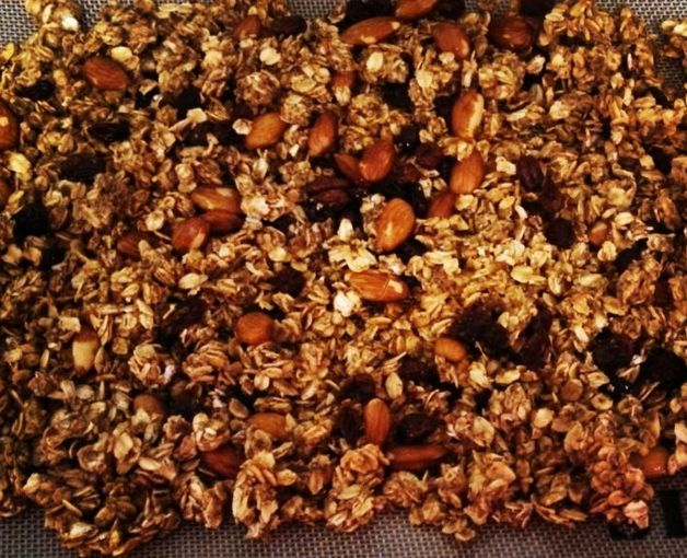 Cinnamon Raisin Granola - 2 cups oats, 1/4 cup ground flaxseed, 1/2 tbsp cinnamon, 2 tbsp coconut oil (melted), 2 tbsp egg whites, 1/4 cup applesauce, 1 scoop vanilla Perfect Fit Protein, 1/4 cup almonds, 1/4 cup raisins. Mix together wet ingredients. Mix remaining ingredients in another bowl. Combine both mixtures, and spread on cookie sheet lined with parchment paper. Drizzle with honey. Bake at 350 degrees for 25-30 minutes. Break into chunks.