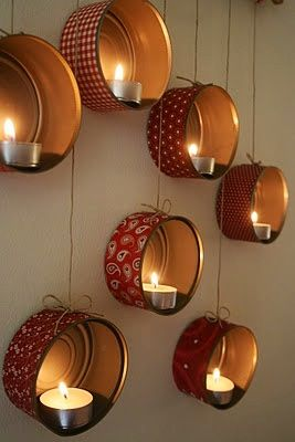 Tins upcycled as candle holders!