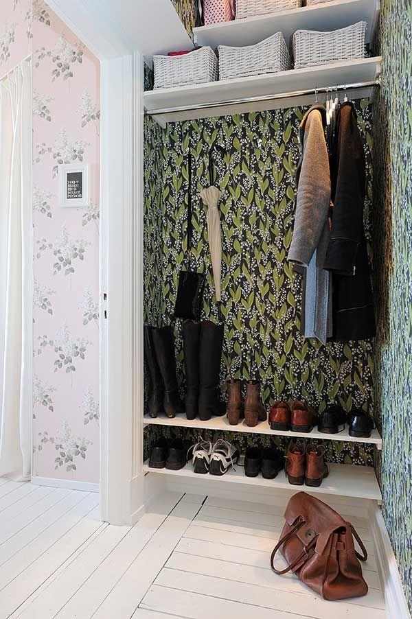 nook closet with wallpaper but no door... more compact spaces at homedit.com