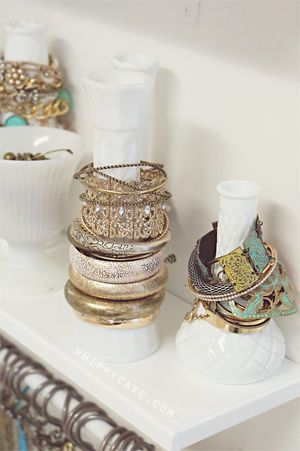 Inexpensive vases (that can be found in abundance at thrift stores!) are used to hold bracelets!
