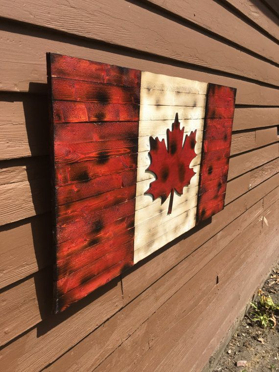 Handmade Wooden Canadian Flag. The red portion and maple leaf are 3/16 inch higher than the rest of the flag to add a 3D like appearance.