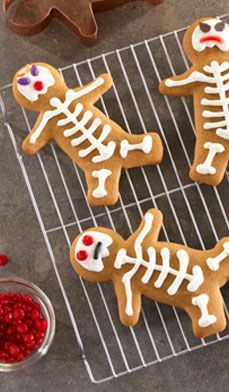 Making Save-a-step Gingerbread Skeletons for your Day of the Dead or Halloween party is easy with the secret ingredient: boxed cake mix! Let the kids decorate with icing and candy. #dessert #recipes #cookies