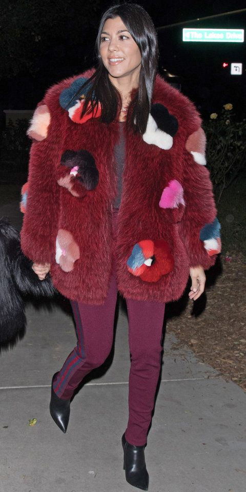 Kourtney Kardashian put a modern twist on an old winter favorite (the fur coat) by choosing a chic color and working the stunning hue throughout her look. The burgundy tones on Kardashian's Fendi jacket ($14,500; farfetch.com) were also the focus on her trousers, solidifying her winning winter look.