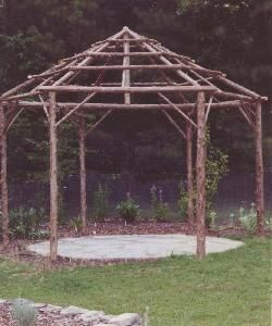 Rustic Garden Structures Pergolas--wouldn't this look great covered in a flowering vine?!