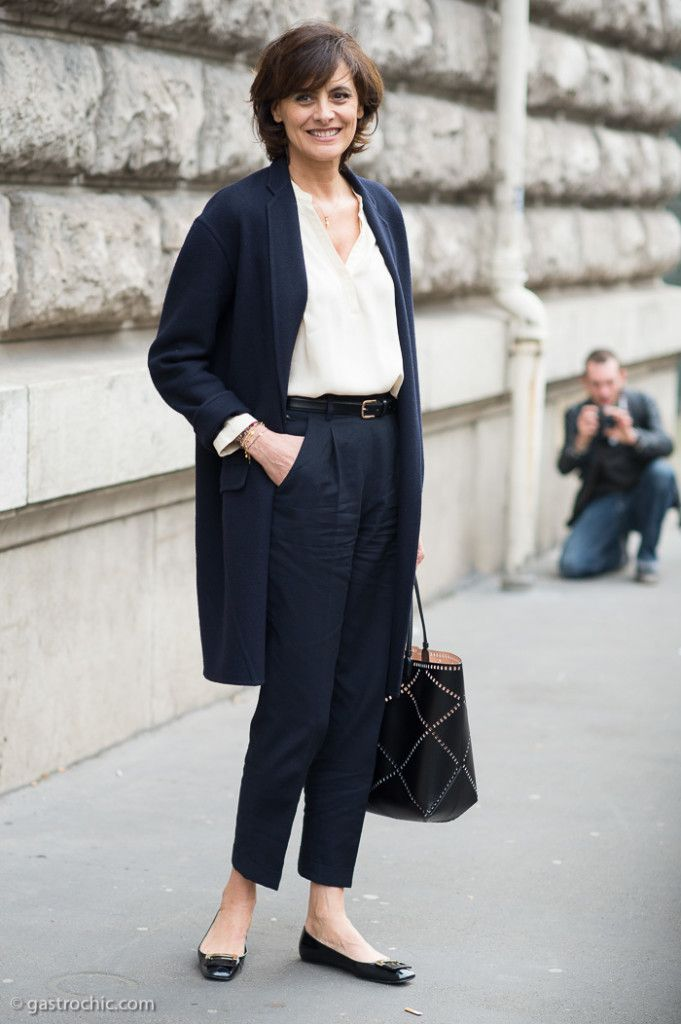 """Ines de la Fressange (57) @ Hermes FW2015. She wore an elegant combination of navy, cream and black to the Hermes show in Paris. """"Mixing BLACK and BLUE"""" is one of the key tenets of fellow French model Caroline de Maigret in her book How to Be Parisian Wherever You Are."""