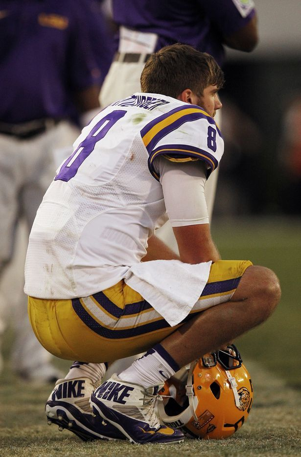 LSU quarterback Zach Mettenberger (8) sits on the sidelines late in the second half of an NCAA football game against Georgia, Saturday, Sept. 28, 2013, in Athens, Ga. Georgia 44-41. (AP Photo/Mike Stewart)