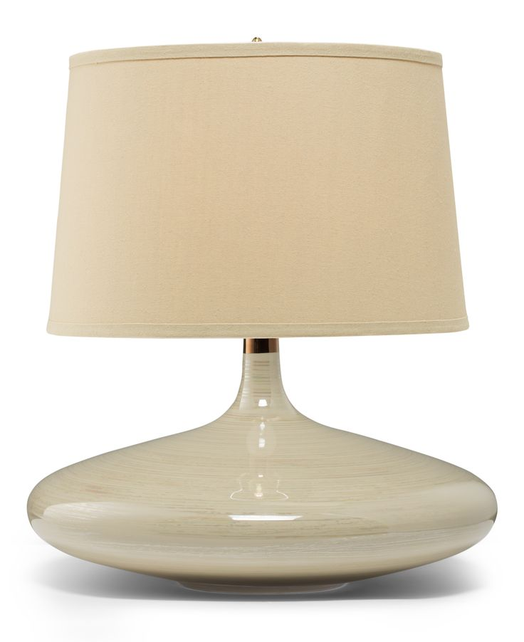 Flora Table Lamp: Beige Table lamps offer the ultimate in the form-and-function department. They bring light to any area: in the living room on a side table, in the master on a bedside table. And the variety of materials and styles is endless, from ceramic to metal to glass.