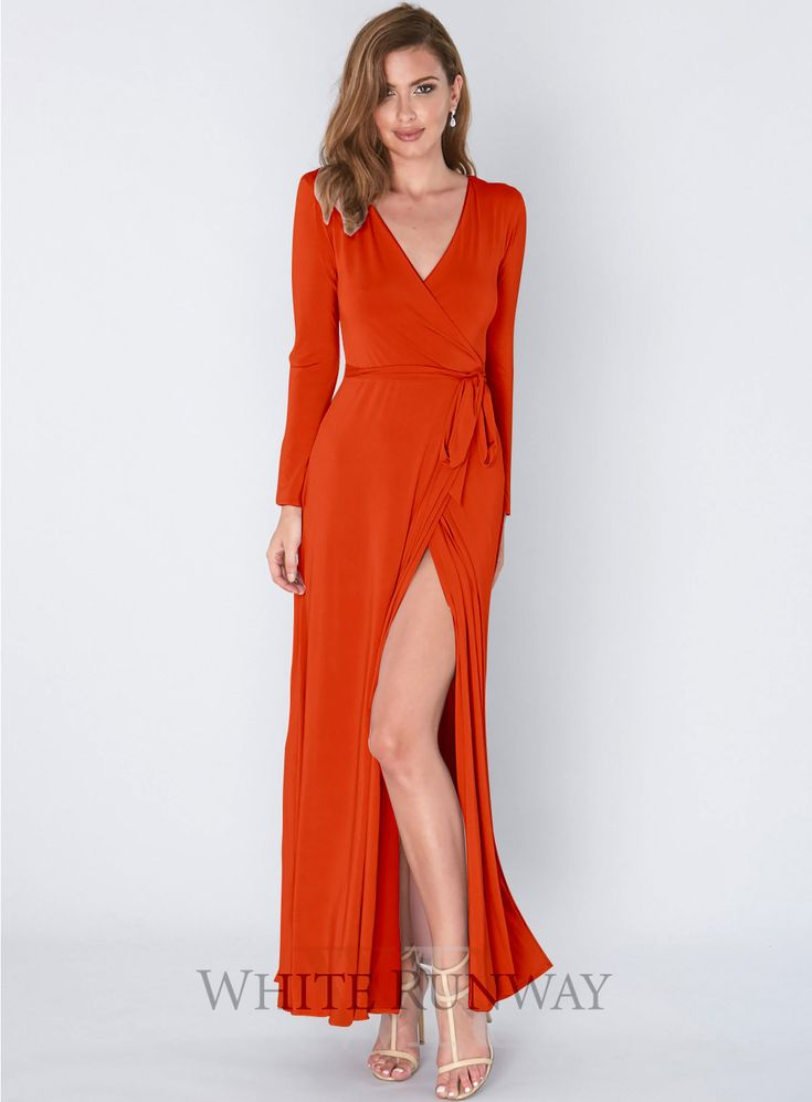 Persia Dress. A beautiful full length dress by Pia Gladys Perey. A long sleeved wrap dress featuring a v-neckline and side split.