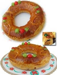 Dutch banket letter   A christmas delicacy puff pastry filled with an almond mixture shaped in a letter like S for Santa   I ice the top with white icing  mixture and decorate with glace cherries red and green like a wreath ...yummy