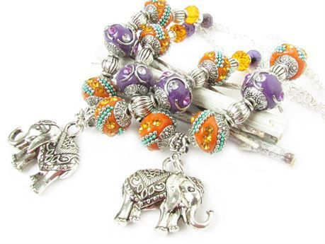 These gorgeous elephant curtain tiebacks will hang prettily from your window curtains. This set of drapery tiebacks have ornate Indonesia beads in purple and orange with tons of bling. These drapery tiebacks have sparkling crystals and purple stone beads for a beautiful touch to your home. These are a cute pair of drapery tiebacks for a nursery as well. MEASUREMENTS: Elephants: 30x33mm These elephants are heavy solid front and back 3D. These measure 18 inches long, and then have a 3